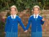 Разделенные сиамские близнецы из Лондона стали школьницами